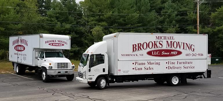 Two Michael Brooks Moving trucks;