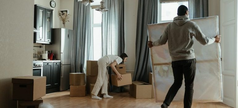 A woman and a man unpacking.