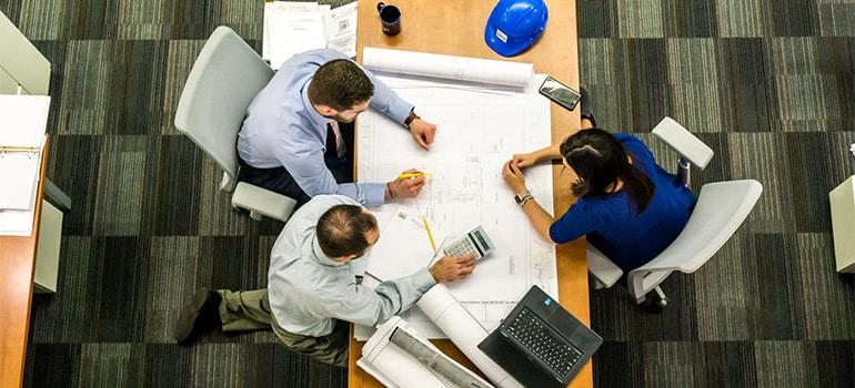 Three people making a plan.